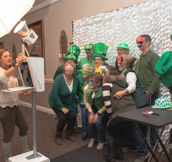 People dressed in green in the photo booth